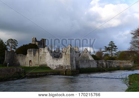 Ruins of Desmond Castle with dark storm clouds above it.