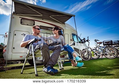 Couple on holiday at a campsite. Caravan car Vacation. Family vacation travel, holiday trip in motorhome. Tourism vacation and traveling.
