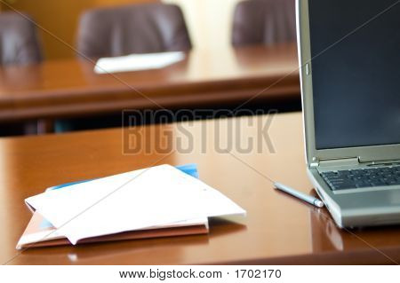 Notebook And Papers In Conference Room