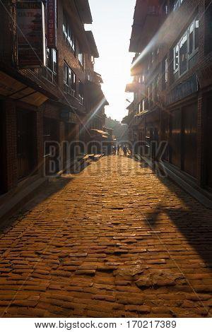 Bhaktapur Brick Cobblestone Alley Morning Sun Rays