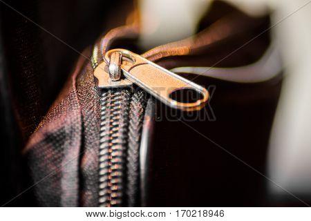 Close up of black leather bag zipper, black leather bag close up