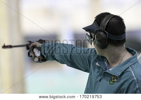 Rio Brazil - august 10 2016: Felipe Almeida Wu (BRA) during shooting 50m Pistol Men Shooting at Olympic Games 2016 in Olympic Shooting Centre Deodoro