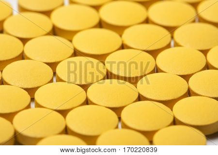 Background Of Bright Yellow Round Tablets Medical
