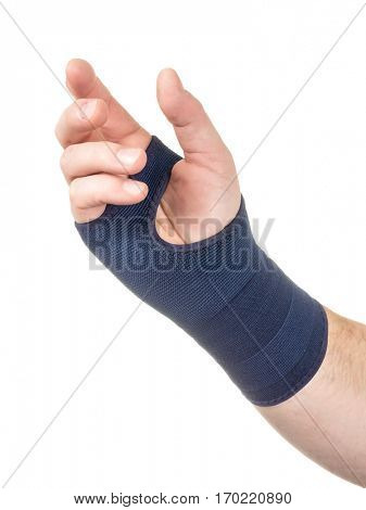 Hand with elastic wrist support isolated on white