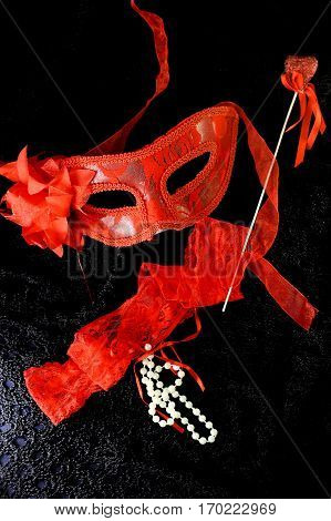 mask women's panties heart on black background heart and pearl beads