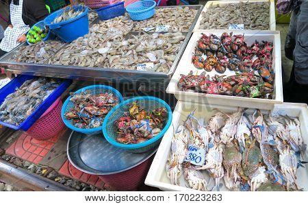 crabs and fish at the market in Bangkok