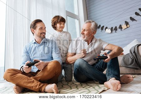 Great atmosphere. Nice cheerful joyful men looking at each other and laughing while playing video games