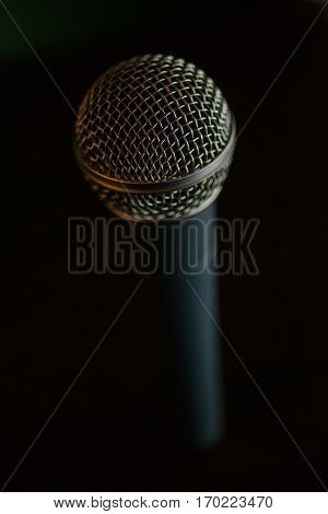 Close up shot of a microphone on a table.