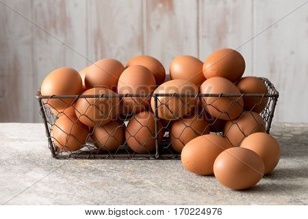 Brown Hen Eggs In A Mesh Wire Tray