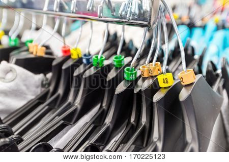 Hangers for clothes in a shop with dimensional marks