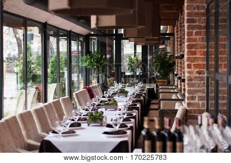 Wedding banquet table decorated with greenery and serve
