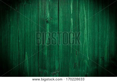 Dark green wood. Natural texture background. Vignette and shadow effect.