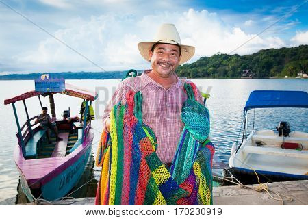 FLORES, GUATEMALA-DEC 20, 2015: Unknown guatamalian hammocks seller on Dec 20, 2015. in Flores , Guatemala.
