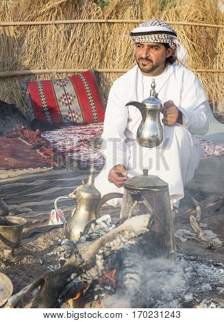 Muscat Oman February 4th 2017: omani man with a traditional coffee pot