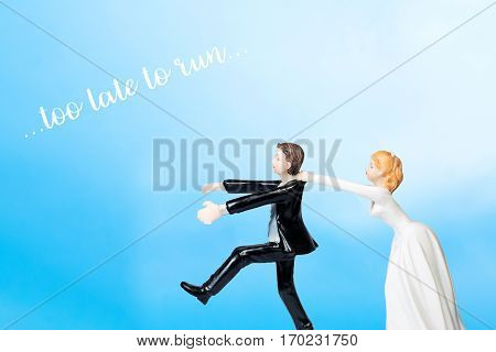 Running groom chased by bride (Wedding concept)