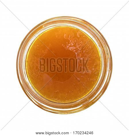 Top view of sugar free apricot preserves in an opened glass jar isolated on a white background.