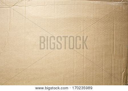 Flat texture of recycled brown cardboard .
