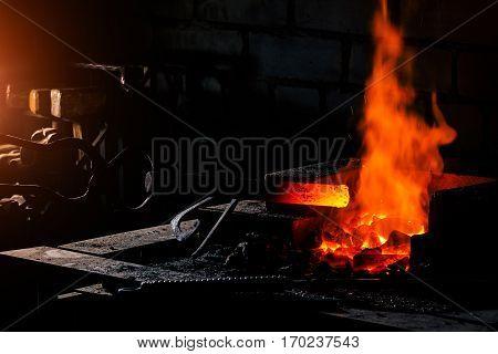 Blacksmith forged iron traditional hammer beating. Stoke