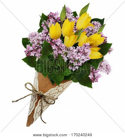 Lilac and yellow tulip flowers bouquet in a craft paper cornet isolated on white