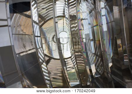 An upclose and abstract view of the glass lenses of the light of a lighthouse.