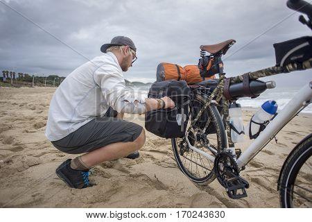 Cyclist Preparing Bicycle