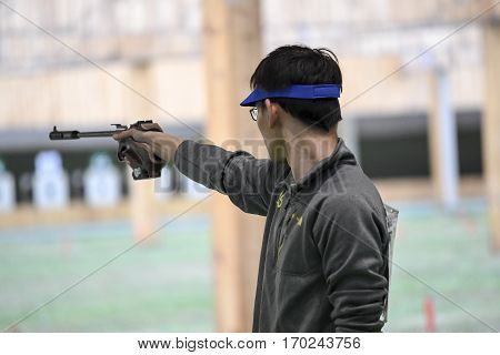 Rio Brazil - august 10 2016: SHI Jay (USA) during shooting 50m Pistol Men Shooting at Olympic Games 2016 in Olympic Shooting Centre Deodoro
