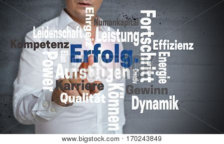 Erfolg (in German Success) Wordcloud Touchscreen Is Operated By Man