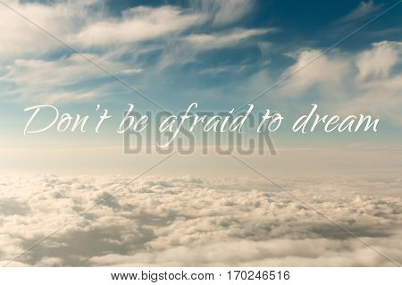 Inspirational motivation quote, do not be afraid to dream, on an abstract sky in sunset background
