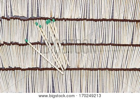 Matches rows folded. Background from matches. abstract.