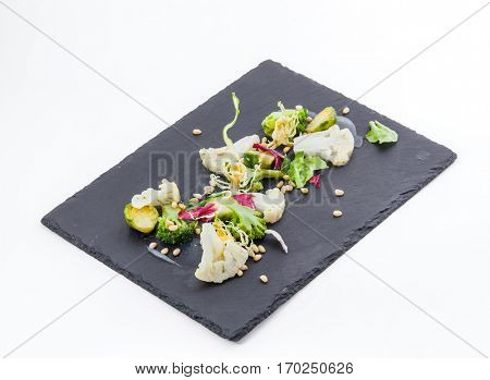 Pieces of herbs cutted on black board