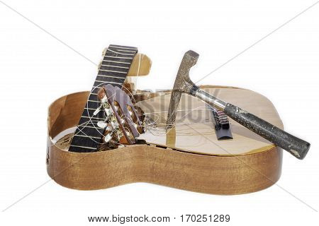 Demolished classical acoustic guitar. Guitar smashed by a hammer.