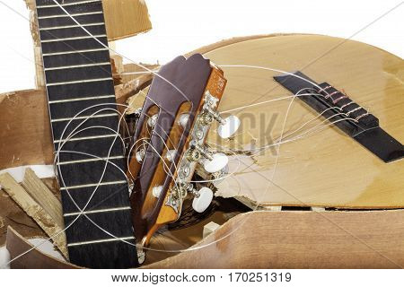 An acoustic guitar that has been broken into bits and pieces by its frustrated musician owner. Not musical after all.