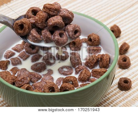 Bowl with cornflakes and Milk on an table