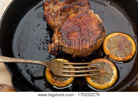 Pork Chop Seared On Iron Skillet