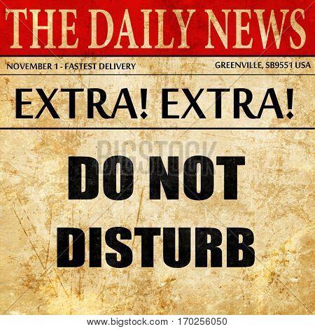 Do not disturb sign, newspaper article text
