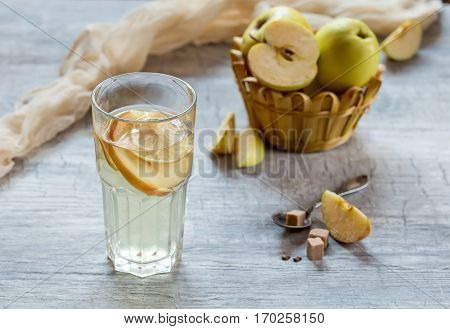 Apple compote glass Cup. Apples in a basket in the background. Selective focus