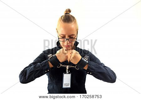 Young beautiful businesswoman screaming with anger prisoner of job in cuffs isolated on white background