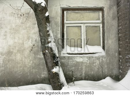 old window. winter landscape. Facades village of houses in the old style. Old vintage window of Russian house