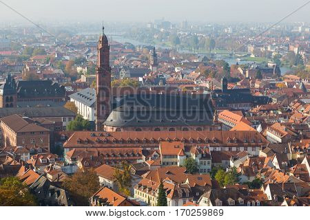 Cityscape of historic city Heidelberg and cathedral Holy Spirit Germany. Top view of roof of the house. Famous tourist destination