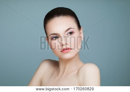 Spa Model Woman with Healthy Skin on Blue Background. Spa Beauty Facial Treatment and Cosmetology Concept