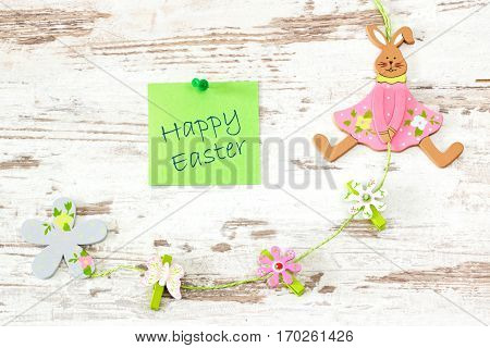 easter bunny with green note on bright wooden background