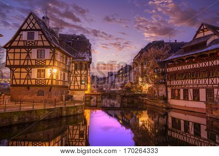 Petit France medieval district of Strasbourg at night, Alsace Franc