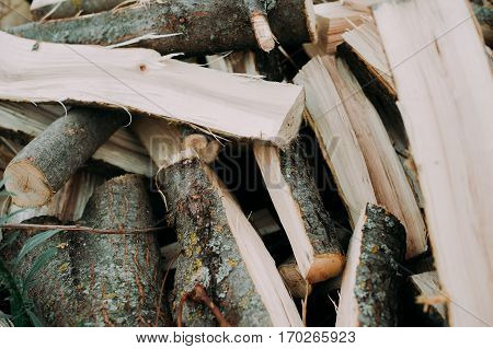 Firewood Background - Chopped Firewood On A Stack