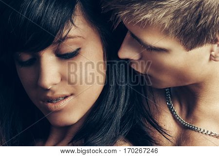 Young couple in love. One moment before the kiss