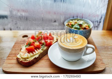 Hummus And Tomato Sandwich, Salad And Fresh Hot Cappuccino Coffee