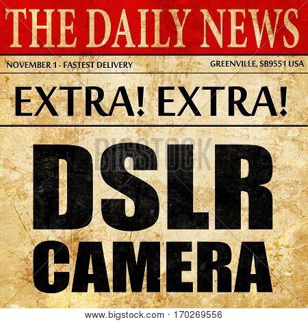 DSLR camera, newspaper article text