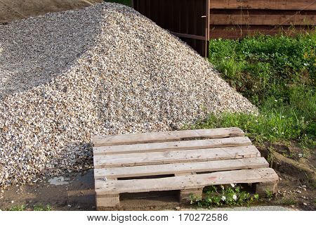 Wooden Pallet And Pile Of Gravel