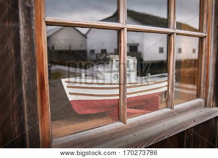Britannia Shipyards National Historic Site. A model fishboat in a window at the historic Brittania Heritage shipyard on the banks of the Fraser River in Steveston, British Columbia, Canada.