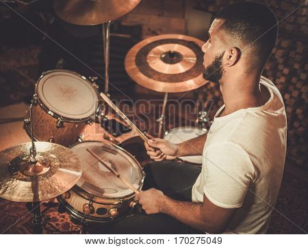 African american drummer in boutique recording studio.