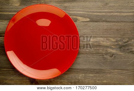 Plate On A Wooden Background. Red Plate. Plate Top View. Copy Space